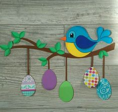 easter bird and eggs on branch
