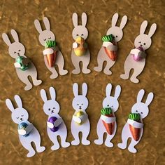 easter little rabbits holding chocloate